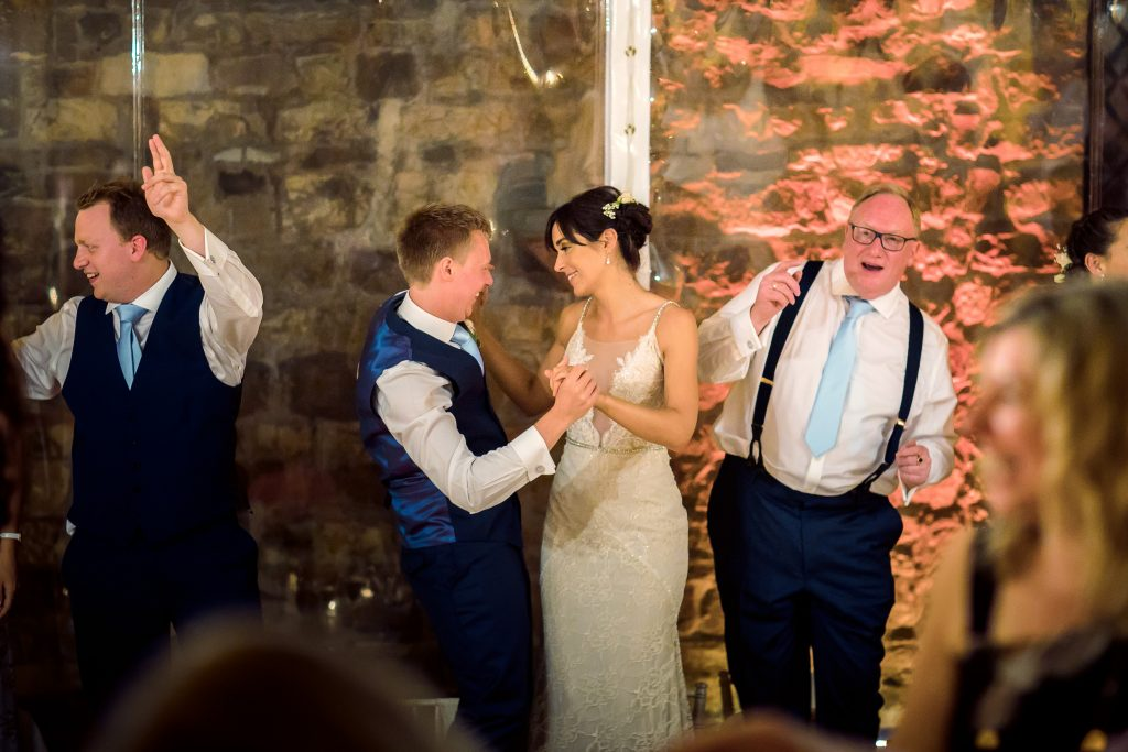 Wedding dancing on chairs and tables