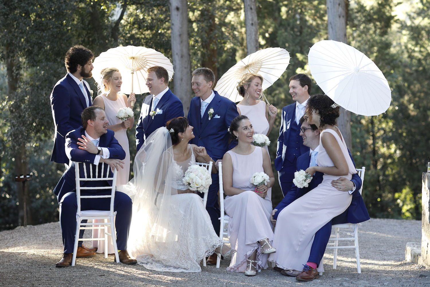group wedding portrait with parasols Italy