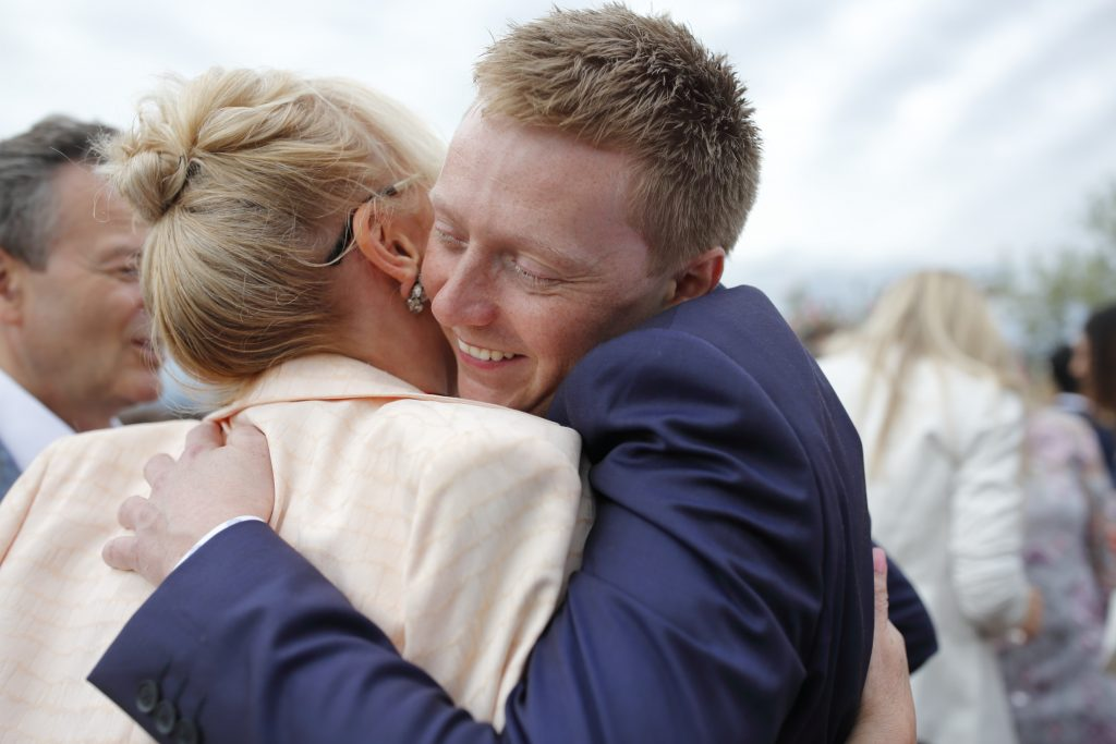 Hug not a handshake wedding planning service