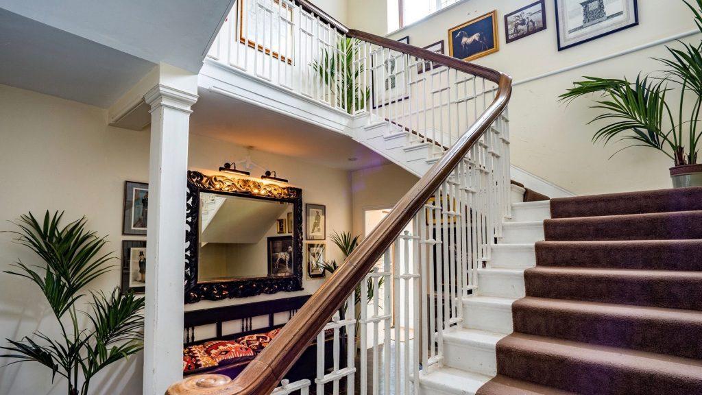 uk destination wedding weekend - destination wedding planner - osea island Manor House staircase