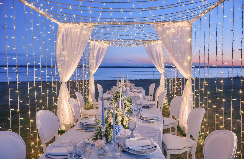 Jewish wedding planner - Jewish destination wedding serpentine table at night